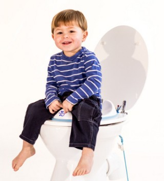 boy on toilet training seat